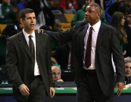 Celtics head coach Brad Stevens, left, chatted with his predecessor, Doc Rivers, after the game.